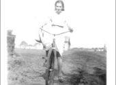Susann cycling to MCI in Gretna, 1937